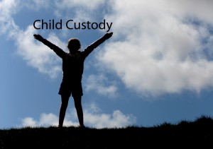 Child Custody - Child arms up on a hill